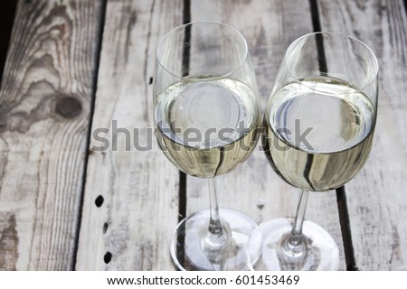 Wine glasses two on a beautiful wooden background.