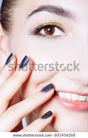 Beautiful glamour young woman with black nails and gold eyeshadows. Posing at the camera. #601456268