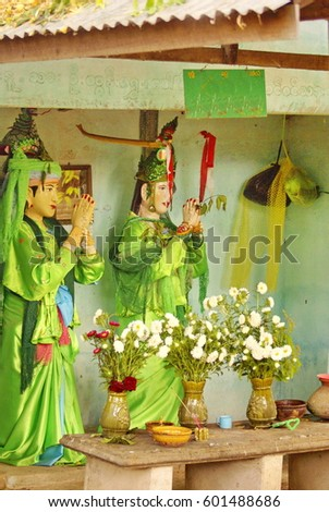 Small shrine with green clothed statues in Bagan, Myanmar #601488686