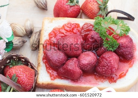 Strawberry jam with slice of bread delicious #601520972