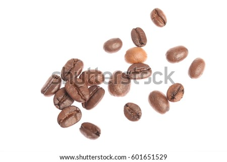closeup of roasted coffee beans isolated on white background #601651529