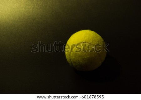 Tennis on  black background. #601678595