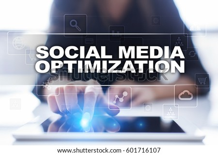 Woman using tablet pc, pressing on virtual screen and selecting social media optimization. #601716107