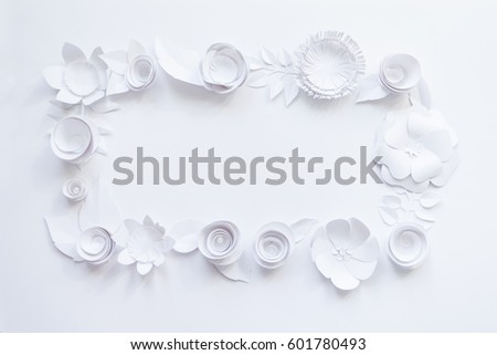 Rectangular frame with white paper flowers on white background. Cut from paper.