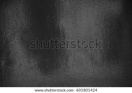 Background texture of shiny black grey foil Royalty-Free Stock Photo #601801424