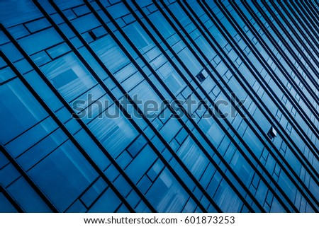Urban abstract - windowed corner of office building #601873253