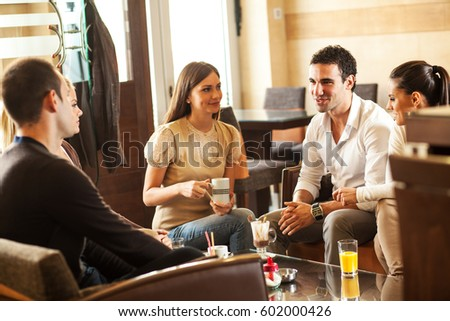 Group of friends hanging out at the cafe. #602000426