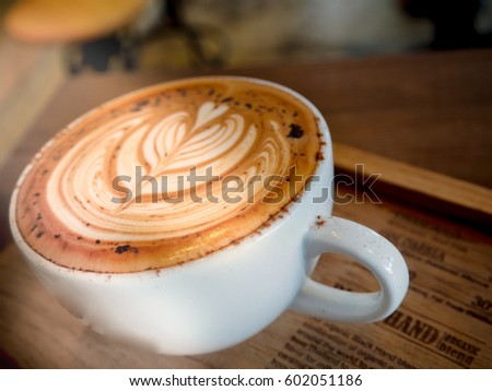 Hot coffee with latte art  drinking coffee