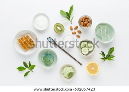 Herbal dermatology cosmetic hygienic cream for beauty and skincare product. honey, lemon, almond, kiwi, cucumber, aloe vera, salt, yogurt on white background. #602057423