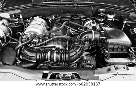 Car engine close-up. Royalty-Free Stock Photo #602058137