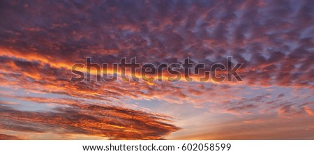 beautiful landscape background with clouds at sunrise #602058599
