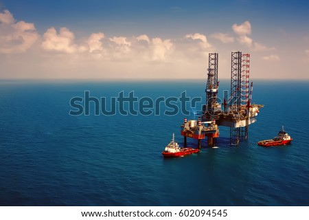 Offshore oil rig platform in the gulf from aerial view,vintage film effect. #602094545