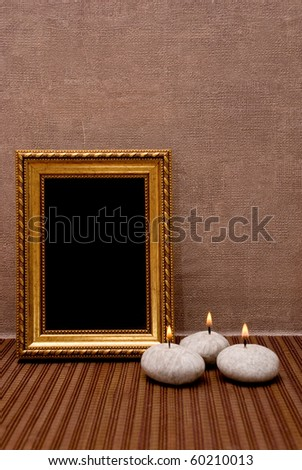 Empty picture frame with candles