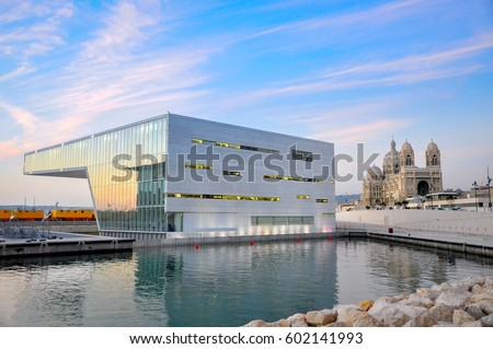 modern architecture against the background of a classical Catholic cathedral #602141993