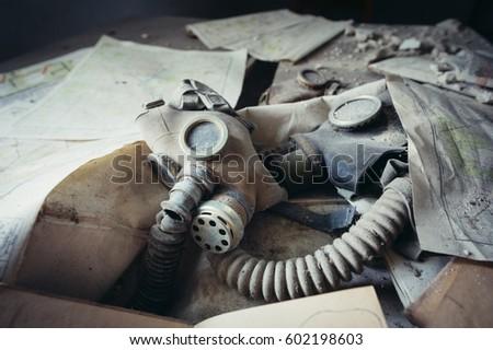 Gas mask in school in deserted Masheve settlement, Chernobyl Exclusion Zone, Ukraine #602198603