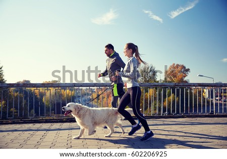 fitness, sport, people and jogging concept - happy couple with dog running outdoors #602206925