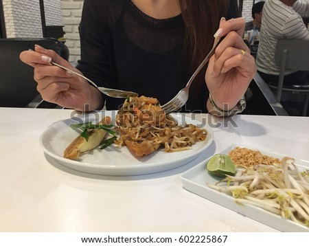 fried noodle with seafood or Padthai, the famous Thai food. #602225867