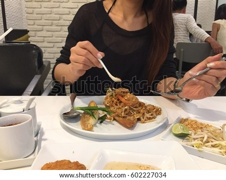 fried noodle with seafood or Padthai, the famous Thai food #602227034