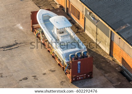 Victoria, Mahe island, Seychelles - December 15, 2015: A white speedboat in the container on the dock of Port Victoria, Mahe island, Seychelles. #602292476