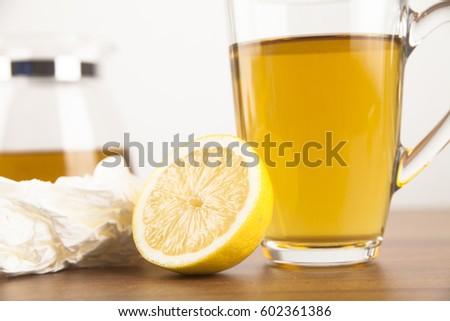 Tea with lemon and handkerchiefs during an illness #602361386