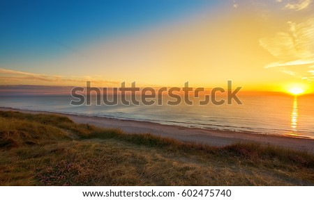 beautiful sunset over the ocean #602475740