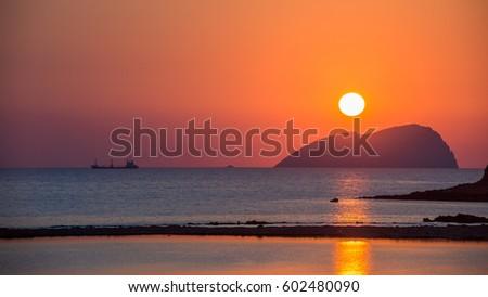 Beautiful sunset in Crete island #602480090