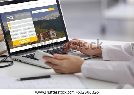 Travel concept. Woman using laptop to plan trip Royalty-Free Stock Photo #602508326