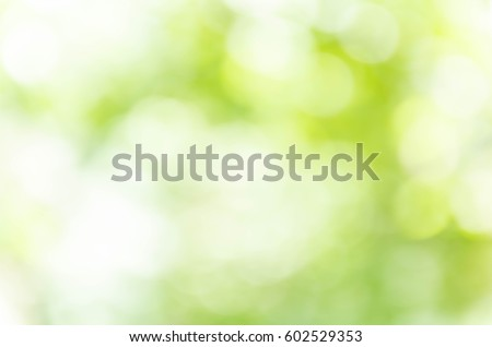 Green bokeh out of focus background from nature forest Royalty-Free Stock Photo #602529353