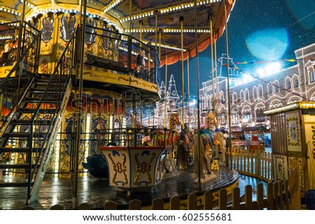MOSCOW, RUSSIA - 21 FEBRUARY 2016. Vintage carousel on the Christmas market, snowy night #602555681