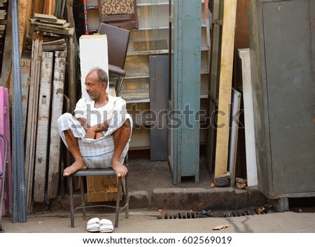Kolkata, India - March 05, 2017: A man selling junk items in his shop. #602569019
