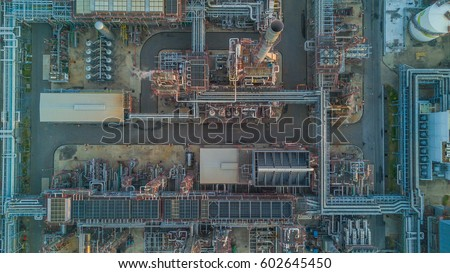 Aerial top view oil and gas tank with oil refinery background at night, Business petrochemical industrial, Refinery factory oil storage tank and pipeline,  Ecosystem and healthy environment concepts. #602645450