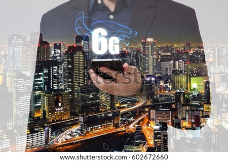 Double exposure businessman using smartphone with 6G network and city overlay background #602672660