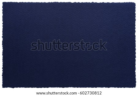 Artistic torn edges paper sheet isolated on white. High quality paper texture in a high resolution. Dark blue background.