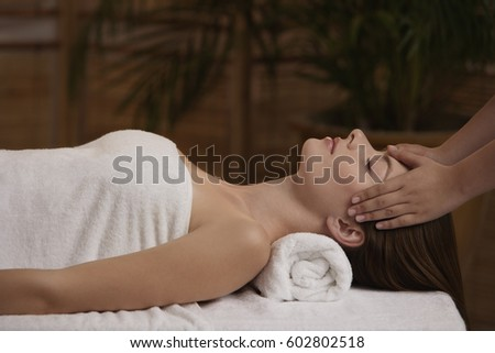 Young woman receiving reiki massage #602802518