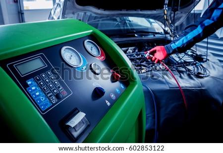Servicing car air conditioner. Service station. Car repair. #602853122
