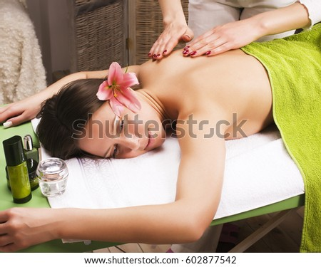 stock photo attractive lady getting spa treatment in salon, healthcare people concept