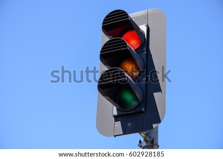 Red traffic lights in the blue sky background