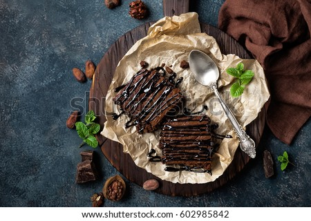 Chocolate brownie cake, dessert with nuts on dark background, directly above #602985842