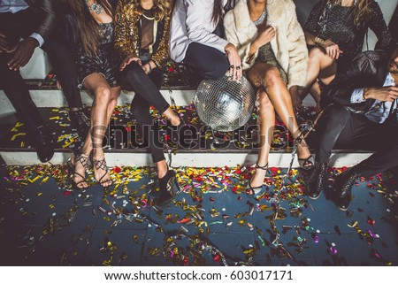 Party people celebrating in the club Royalty-Free Stock Photo #603017171