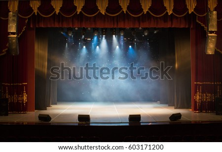 An empty stage of the theater, lit by spotlights and smoke before the performance Royalty-Free Stock Photo #603171200