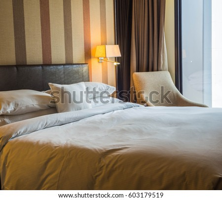 Luxury bed room with a white linen bed sheet in vintage tone color. #603179519