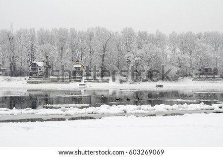 Winter landscapa with a small and cute house #603269069