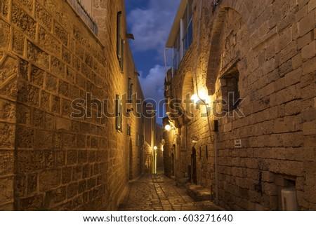 Medieval street at night in Jaffa, Tel Aviv, Israel #603271640