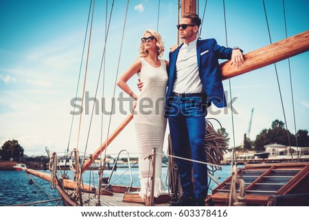 Stylish wealthy couple on a luxury yacht. #603378416