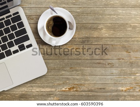 High angle view of office desk with copy space. Table with laptop and cup of coffee. Flat lay. Freelancer or student desk. Top view with copy space for design #603590396