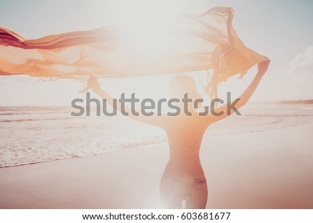 woman silhouette on exotic ocean beach. blurred vintage picture. summer background #603681677