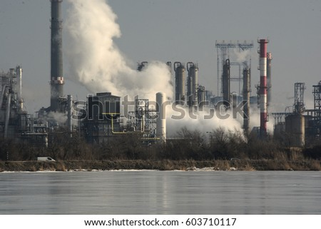 Detail of smoking chimneys of a petrochemical factory in an oil refinery in Constanta - Romania #603710117
