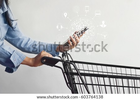 woman using mobile payments online shopping and icon customer network connection on screen, m-banking and omni channel Royalty-Free Stock Photo #603764138