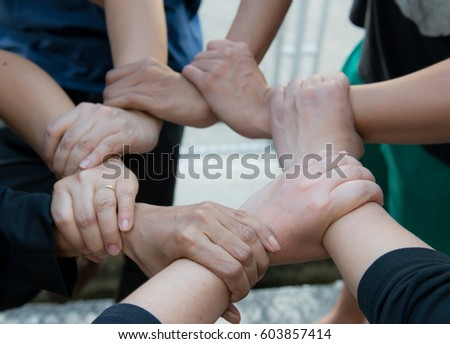 Conceptual image of teamwork by hand ,catch wrist by clinging continue happened from muscle of hand, Human Hand, Connection, Teamwork, people stand around the world and hold hands #603857414