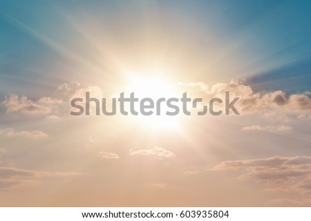 Bright sun in the blue sky with clouds #603935804